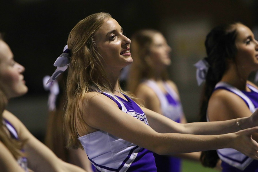 Madeline Drummond cheers at a home football game.