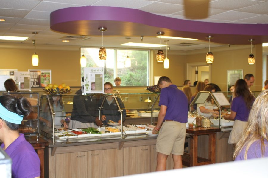 Our cafeteria is in many ways the center of student life. Students stand crowded in the lunchroom.