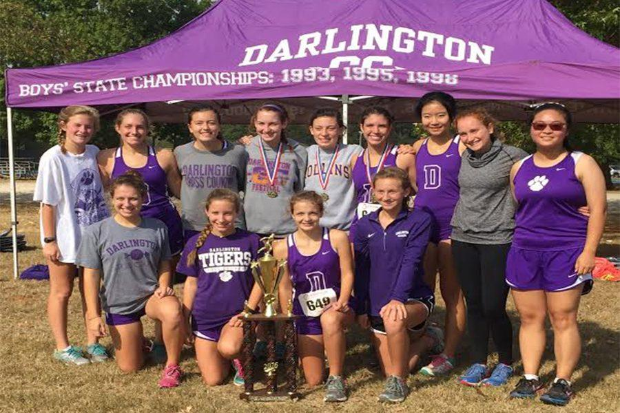 Girls Cross Country with their Rome All-Area trophy.