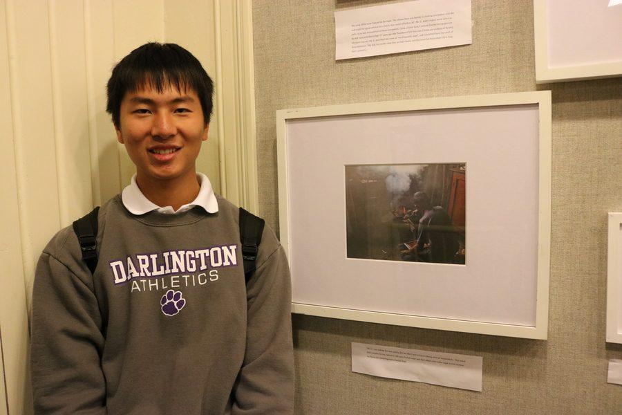 Sam Ding next to his favorite photo. Photo by Trang Khuc.
