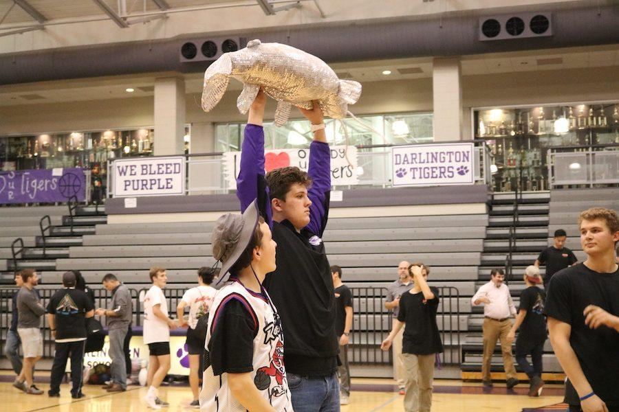 Summerbell share their victory with Cooper by lifting up their mascot.