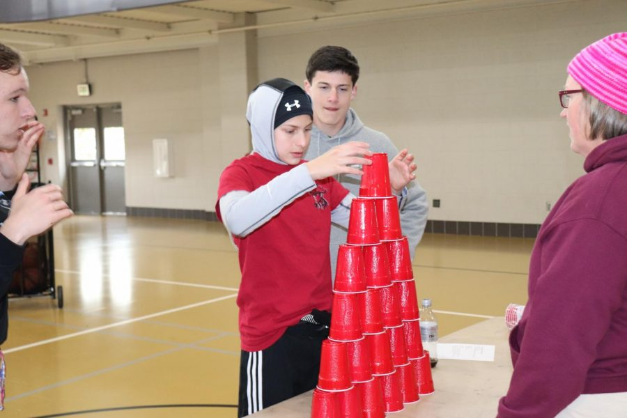 Sophomore Andrew Ferderer stacks cups for Summerbell.