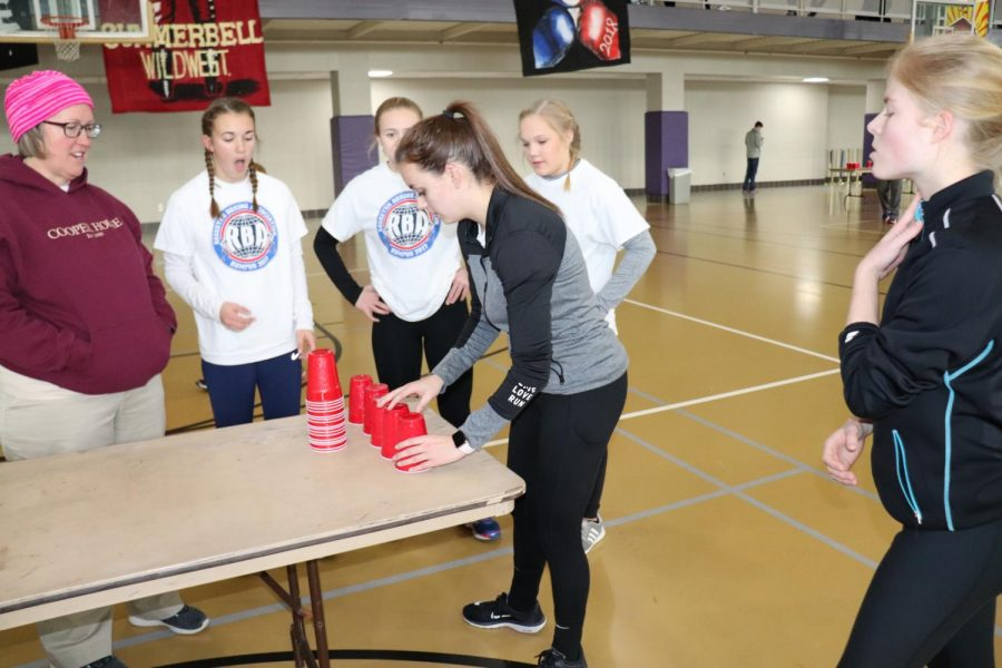 Junior Raechel Irby begins her cup pyramid for Regester.