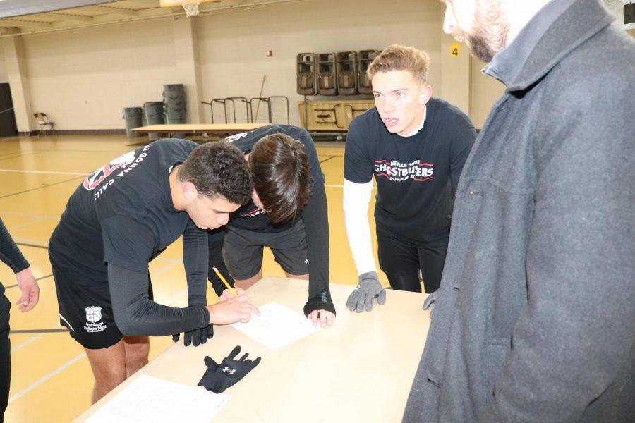 Seniors Nicko Clarke and Fonso Rodriguez-Tubio do sudoku for Neville.