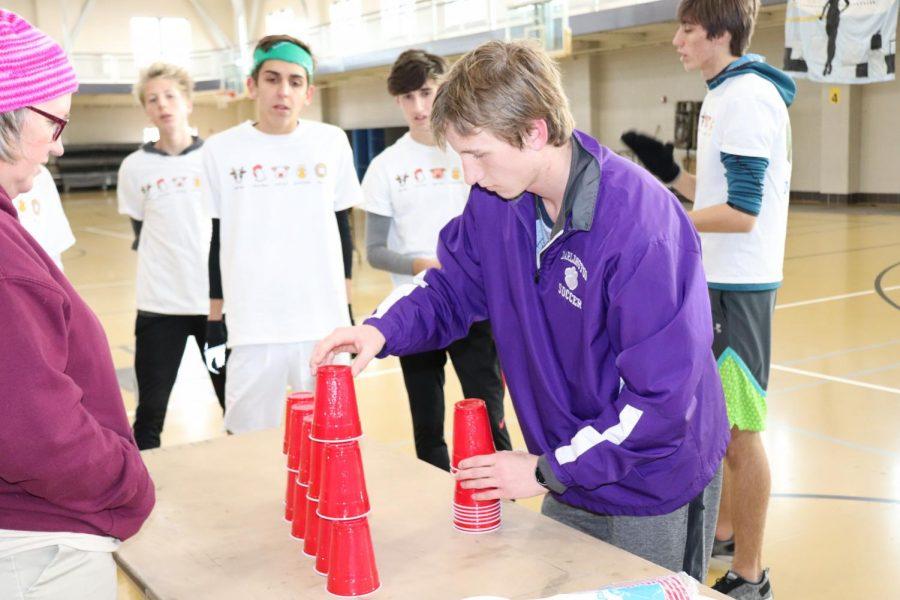 Junior Jonathan Pieroni stacks cups for Moser.