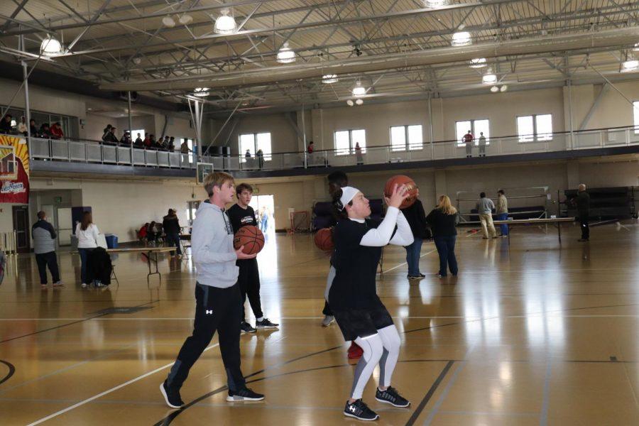 Senior Karl Swiger attempts to make a foul shot.