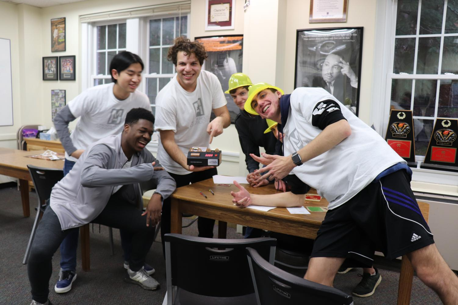 Moser House posing next to their completed escape room, and is the only house to finish the task.